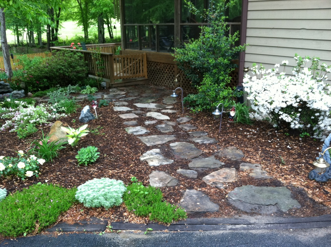 Photo gallery 1 for Installing river rock landscaping